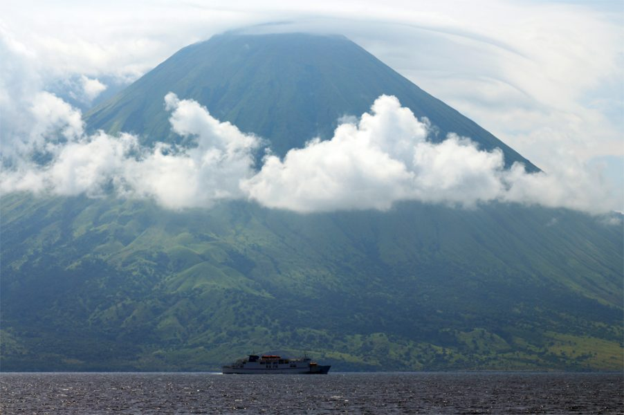 Getting things in perspective: a seemingly tiny ferry passes by the temperamental Sangerang volcano